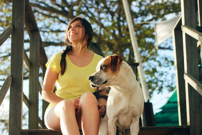 women with a dog image